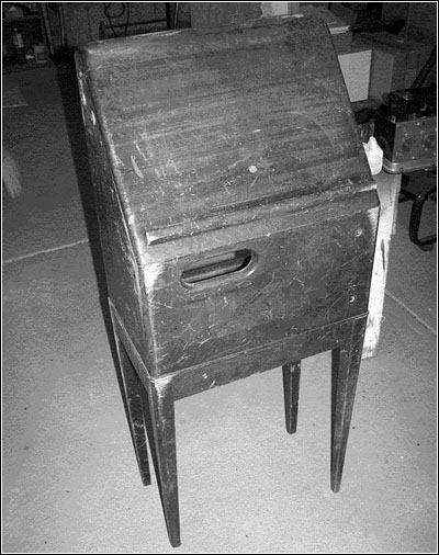 The cabinet before restoration.