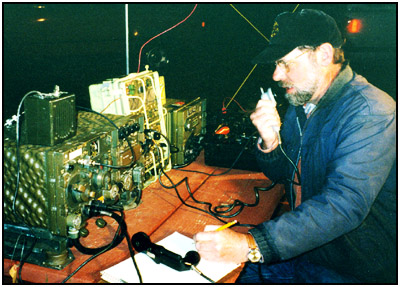 "Dick Dillman, W6AWO, kept the bands alive with his ""Command Post"" in the RV Camp area."