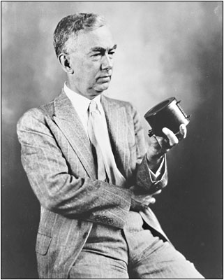 Frank Conrad holds a microphone in a 1921 portrait.