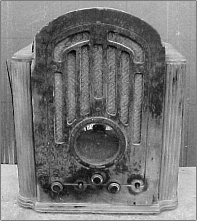 The cabinet of the RCA shows the extent of the water damage
