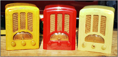 three Emerson AU-190s in yellow, red and cream