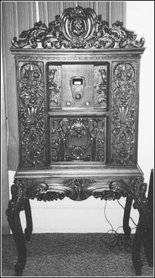 This ornate Howard Model 5-A highboy console