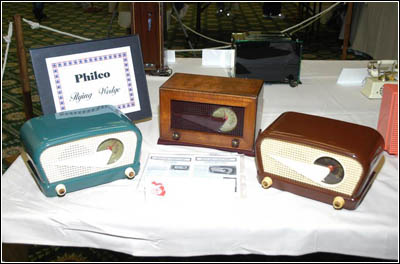 "hree examples of Philco's ""Flying Wedge"" series of radios"