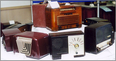 An assortment of 1940s and 1950s wood and plastic table radios