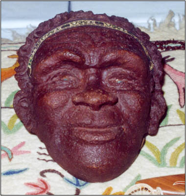 a 1960s transistor radio in the shape of an Australian Aboriginal face