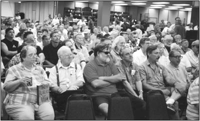 The attentive crowd waits for the bidding to start. Edith and Ray Chase will soon begin recording the auction for A.R.C. in the front row, left.
